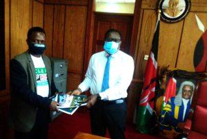 Clean Up Kenya Founder hands 'Talking Trash' Report to Kenyan Speaker